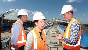 Transport Minister Andrew Constance, Premier Gladys Berejiklian and incoming Transport for NSW Secretary Rodd Staples inspect progress on Sydney Metro Northwest.