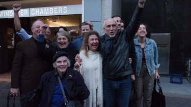 Save Our Sirius campaigners celebrate the win outside court.
