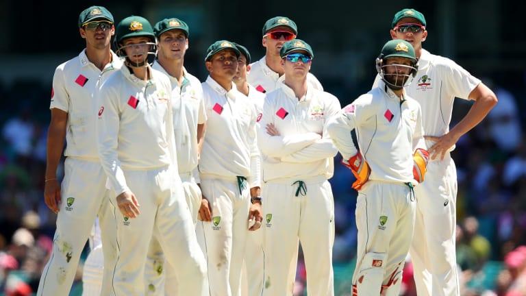Where's the cash? Australian players wait for a DRS decision . Getty