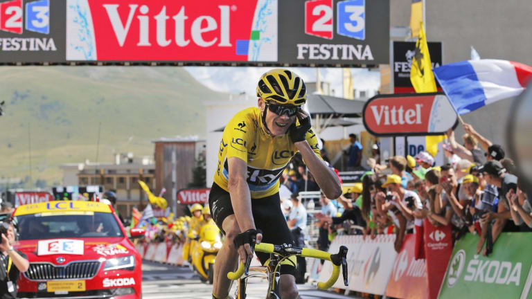 Safely home: Chris Froome crosses the finish line after stage 20.