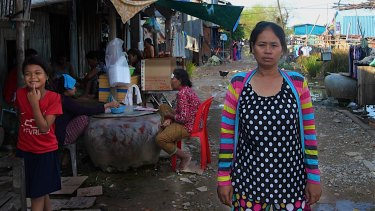In the flood-prone squatter settlement village on the outskirts of the Cambodian capital, Hour Vanny says she was required under a contract to give birth by cesarean section.