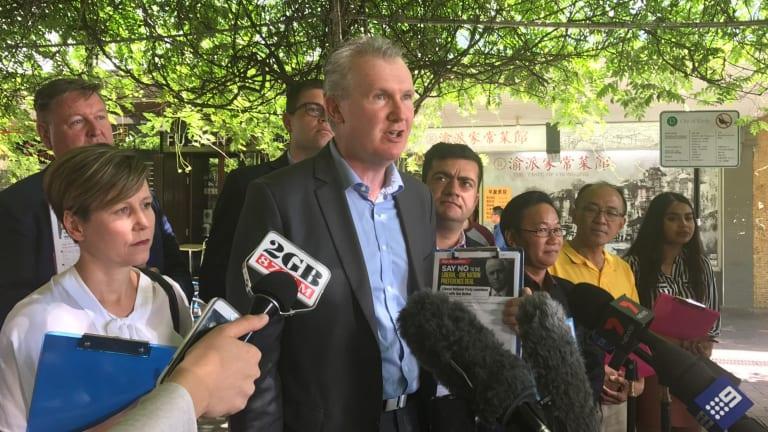 Labor MP Tony Burke (centre) with Senators Sam Dastyari (right) and Jenny McAllister (left) speak to journalists in Bennelong.