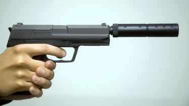 A gun with a silencer attached.