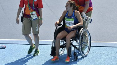 Abbey D'Agostino is helped from the track in a wheelchair