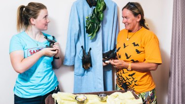 ACT Wildlife Flying Fox coordinator Kirstie Hawkins with Hannah Calderwood who is learning how to look after the bats.