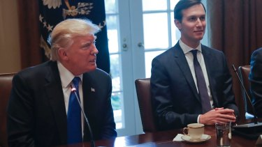 US President Donald Trump with his son-in-law and advisor, Jared Kushner, who has been charged with striking peace in the Middle East.