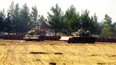Turkish army tanks are stationed near the border with Syria, in Karkamis, Turkey.