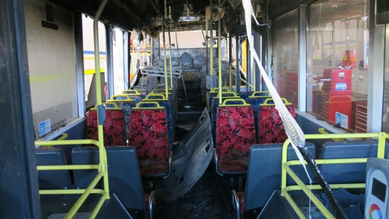 The interior of the destroyed bus, with the Opal reader in the right foreground.