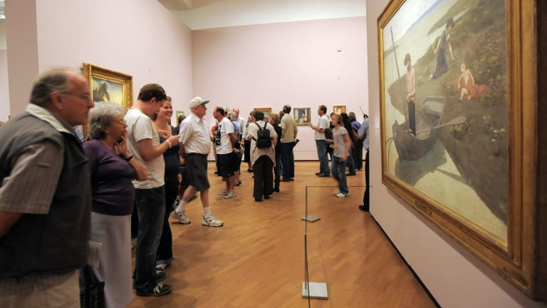 Visitors  at the 2010 Masterpieces from Paris exhibition at the National Gallery of Australia.