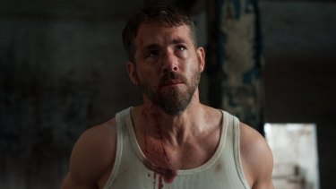 Ryan Reynolds, hotter than a Carolina Reaper  chilli right now, is killed off in the first reel of <i>Criminal</i>.