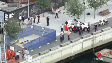 Police and emergency services attend the scene of a workplace accident on a barge at Barangaroo.