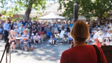 Greens MLA Caroline le Couteur addresses protesters at Curtin  Square.