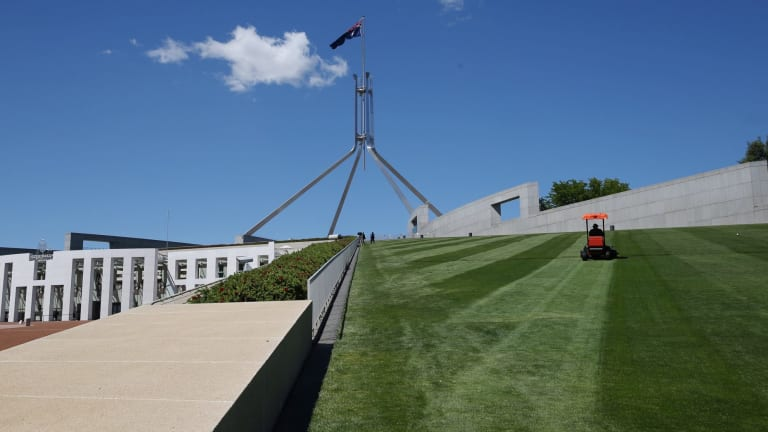 Instead of a berm or moat, a new fence will cut across the lawns at Parliament House.