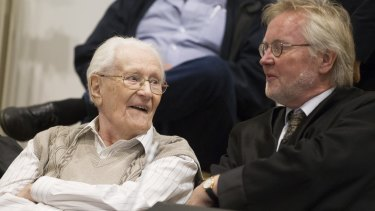 Oskar Groening and his lawyer Hans Holtermann during the first day of his trial.