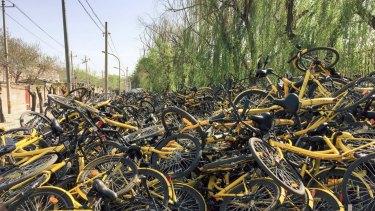 """A """"graveyard"""" for broken Ofo bikes in Beijing."""