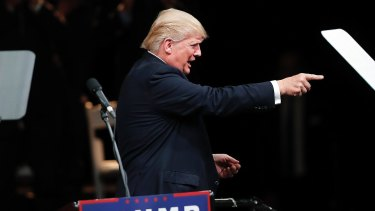 Republican presidential candidate Donald Trump: a face over the crowd.