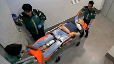Security camera footage showing Kim Jong-un on a stretcher at Kuala Lumpur International Airport.