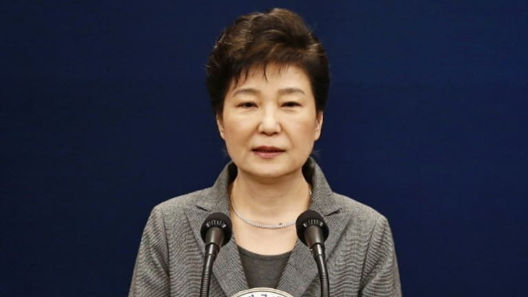Park Geun-hye, pictured in November, is accused of colluding with long-time friend Choi Soon-sil to pressure big businesses to make contributions to non-profit foundations backing presidential initiatives.