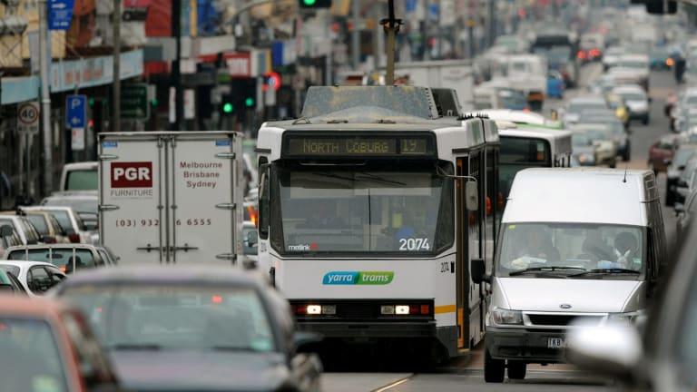 A tram makes its way through heavy traffic on Sydney Road, Brunswick.