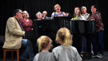 Beth Rankin and Warren Wills (far left) with Choir of Hard Knocks singers during rehearsals.