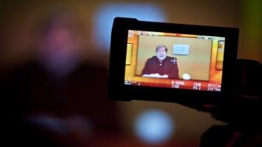 An attendee at the Brisbane summit films Mr Wozniak's broadcast.
