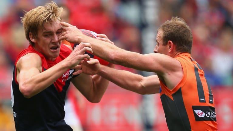 Tough at the ball: Steve Johnson challenges Demon Oscar McDonald.