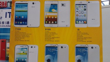 A poster at the China Information Technology Expo advertising fake phones. Top left is a Samsung Galaxy Note II knock-off, while top right is an iPhone 5 fake. In the bottom row are two Galaxy S3 knock-offs.
