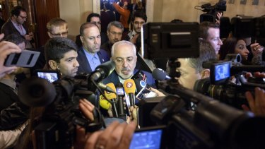Iranian Foreign Minister Mohammad Javad Zarif, centre, speaks after meetings with the German and French foreign ministers in Lausanne, Switzerland on Saturday.