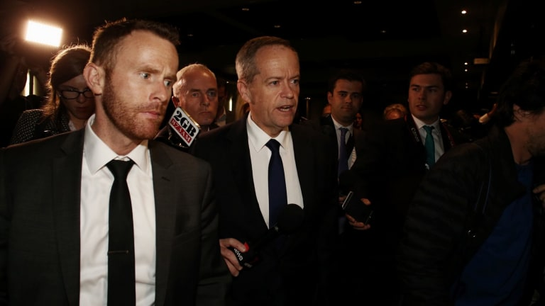 Opposition Leader Bill Shorten is questioned about AFP raids on ALP offices and staff as he departs the Bankstown Sports Club in Sydney.