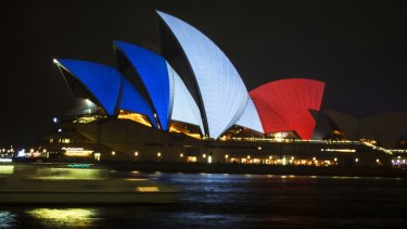 The Sydney Opera House lit up in red, white and blue.
