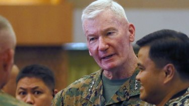 Lt. Gen. John Toolan, US Commander of US Marine forces in the Pacific, chats with Vice-Admiral Alexander Lopez, right, following the opening ceremony of their annual joint military exercise, dubbed Balikatan 2016.