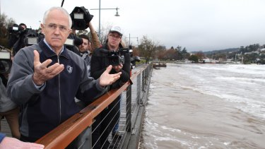 Prime Minister Malcolm Turnbull at the flooded Tamar River and the levee in Launceston.