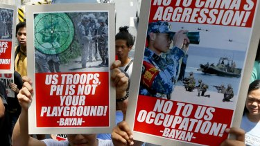 Protesters display placards against China and US during a rally near the US Embassy to coincide with the start of the annual joint US-Philippines military exercise.