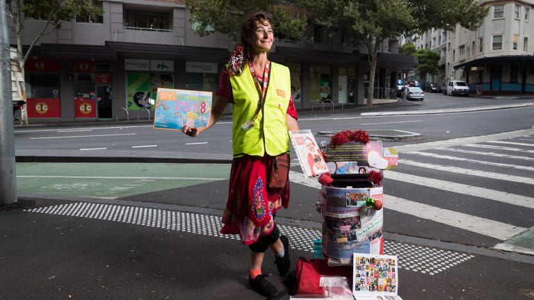 Big Issue vendor Rachel T stands with her trolley in Pyrmont where she has a regular spot.
