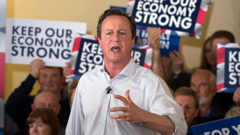 British Prime Minister David Cameron speaks to party supporters gathered inside the village hall in Norton-sub-Hamdon in the Yeovil constituency last Sunday.