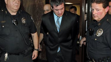 Daniel Holtzclaw cries as he is led from the courtroom.