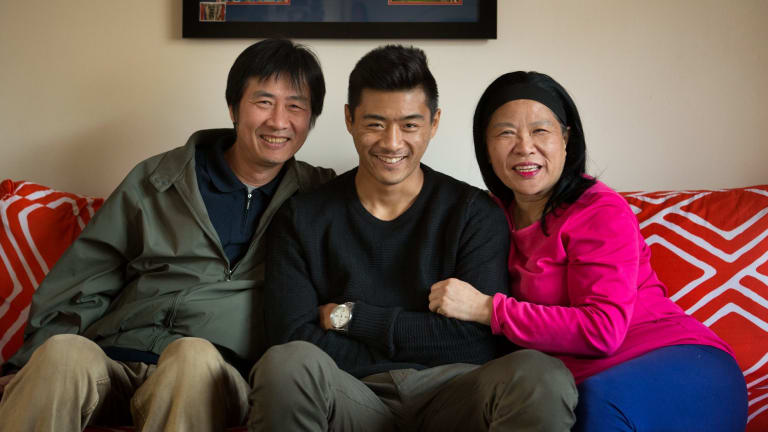 Lin Jong with his parents Vitor and Fay.
