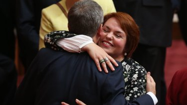 Senator Kimberley Kitching is embraced by Opposition Leader Bill Shorten after her first speech in the Senate last year.