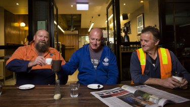 Construction workers (from left) Ron Horn, David Jones and Theo Argyros having early morning coffee before  work, at Spriga Espresso Bar on King Street, Melbourne.