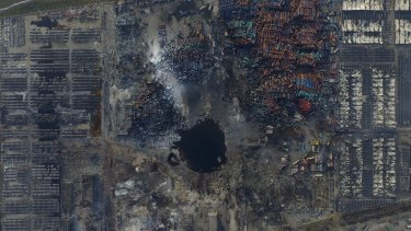 An aerial picture shows the crater at the blast site in Binhai new district, Tianjin.