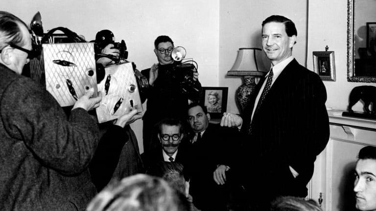 Kim Philby is surrounded by media at his mother's home in West Kensington after his name surfaced in the MacLean-Burgess inquiry, November 1955.