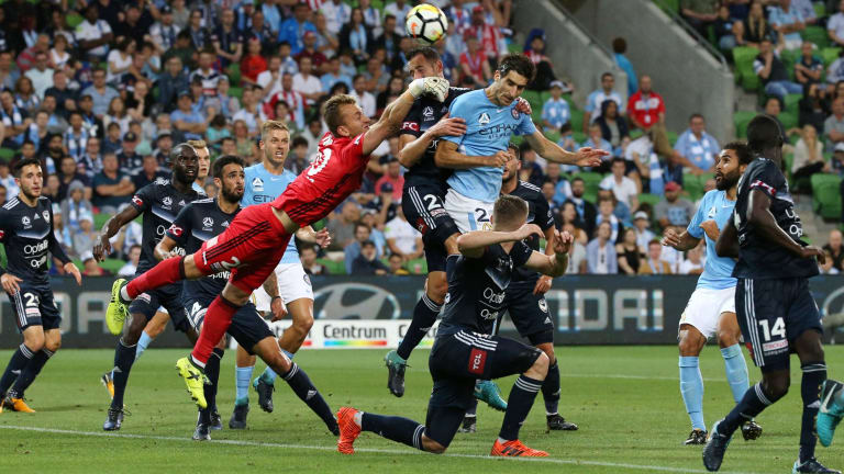 Tale of two keepers: Lawrence Thomas of Melbourne Victory clears the ball from a congested red zone.