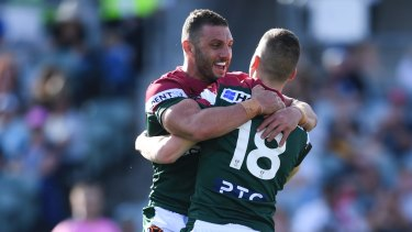 Adam Doueihi (right) celebrates with Robbie Farah after scoring a try for Lebanon during the Rugby League World Cup.