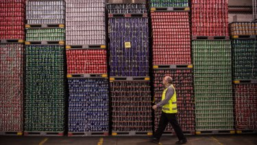 Bottles are stacked at Coca Cola's Northmead plant.