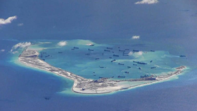 Chinese dredging vessels are purportedly working in the waters around Mischief Reef in the disputed Spratly Islands in the South China Sea.