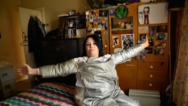Donna Staehr at her Adelaide home in a radiation suit designed to treat her Morgellons symptoms.