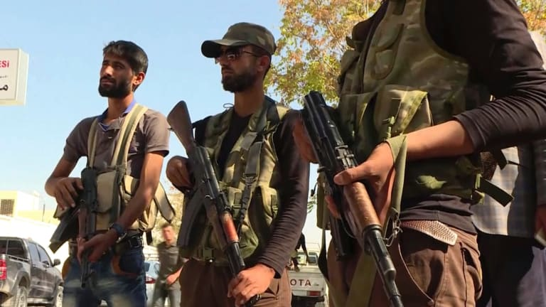 Turkish-backed Syrian opposition forces patrol in Dabiq, Syria.