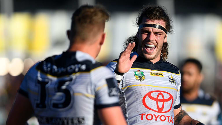 On fire: Ethan Lowe, right, reacts to Coen Hess' try.