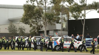 Members of Victoria Police and paramedics at Ravenhall prison where inmates rioted.