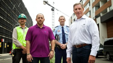 Suicide prevention conference speakers and attendees Myles Jackson(MIRVAC Health Safety Environment Officer), suicide survivor Kevin Hines, NSW Police Inspector Joel Murchie and Kevin Briggs, the former cop patrolling the Golden Gate Bridge.    Photo: Wolter Peeters The Sydney Morning Herald